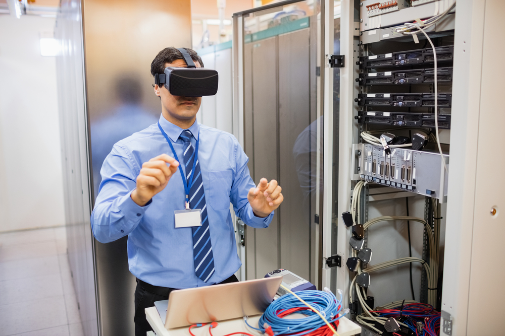 Technician using visual reality headset in server room